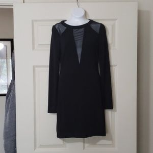 Express black long sleeve with sheer neckline.